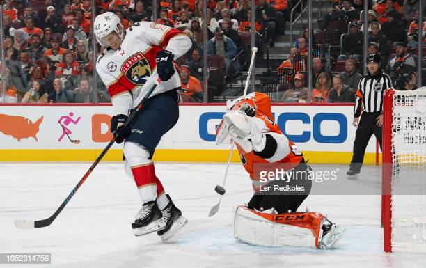 Nick Bjugstad of the Florida Panthers attempts to screen goaltender Brian Elliott of the Philadelphia Flyers as a shot comes through on October 16...