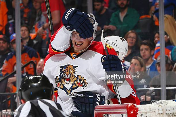 Nick Bjugstad of the Florida Panthers celebrates his second period goal with Jussi Jokinen against the New York Islanders in Game Three of the...