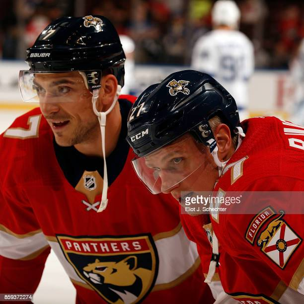 Nick Bjugstad of the Florida Panthers chats with teammate Colton Sceviour during warm ups prior to the start of the game against the Tampa Bay...
