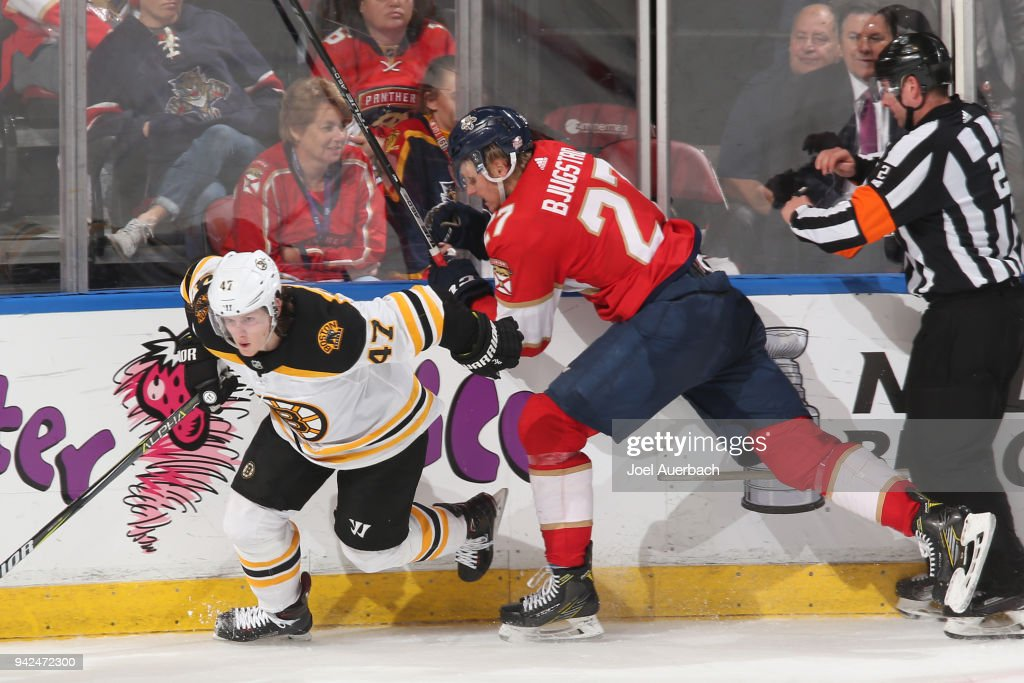 Nick Bjugstad #27 of the Florida Panthers checks Torey Krug #47 of the Boston Bruins during third period action at the BB&T Center on April 5, 2018 in Sunrise, Florida. The Panthers defeated the Bruins 3-2.
