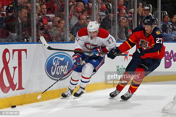 Nick Bjugstad of the Florida Panthers checks Torrey Mitchell of the Montreal Canadiens off the puck behind the net during second period action at the...