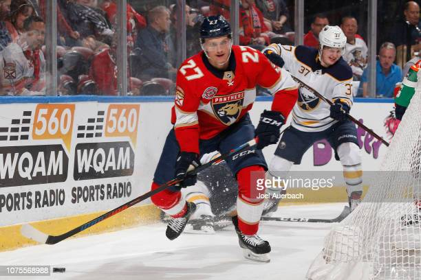 Nick Bjugstad of the Florida Panthers circles behind the Buffalo Sabres net during first period action at the BBT Center on November 30 2018 in...