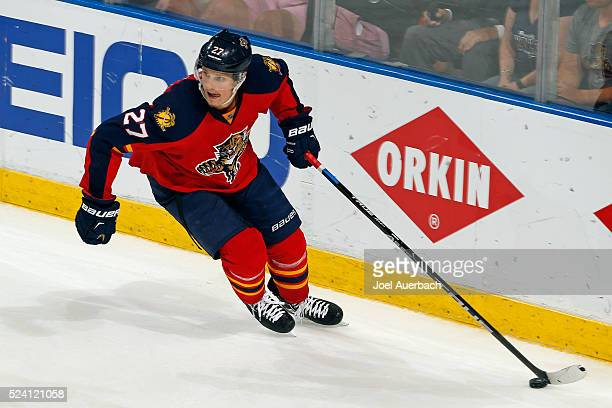 Nick Bjugstad of the Florida Panthers clears the puck against of the New York Islanders during the first overtime period in Game Five of the Eastern...