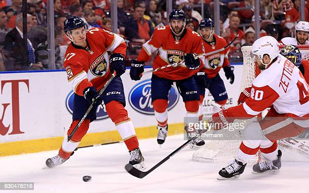 Nick Bjugstad of the Florida Panthers clears the puck during a game against the Detroit Red Wings at BBT Center on December 23 2016 in Sunrise Florida