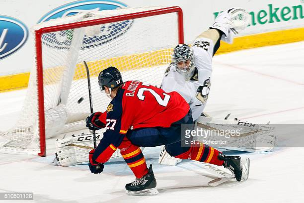 Nick Bjugstad of the Florida Panthers scores in a shoot out against Goaltender MarcAndre Fleury of the Pittsburgh Penguins at the BBT Center on...