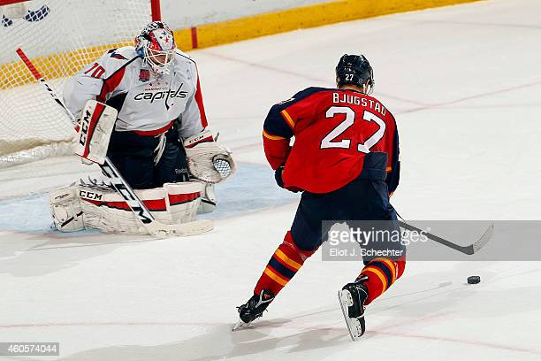 Nick Bjugstad of the Florida Panthers shoots and scores for the shootout win against Goaltender Braden Holtby of the Washington Capitals at the BBT...