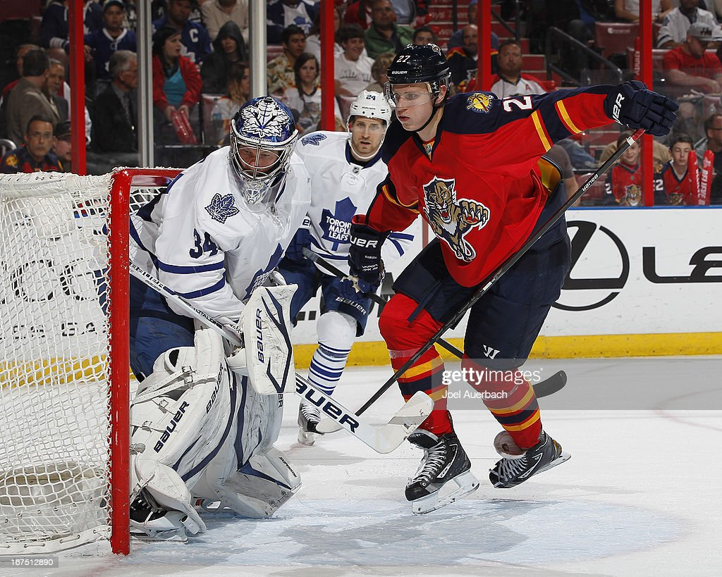 Nick Bjugstad #27 of the Florida Panthers skates towards the loose puck as goaltender James Reimer #34 of the Toronto Maple Leafs defends the post at the BB&T Center on April 25, 2013 in Sunrise, Florida. The Maple Leafs defeated the Panthers 4-0.