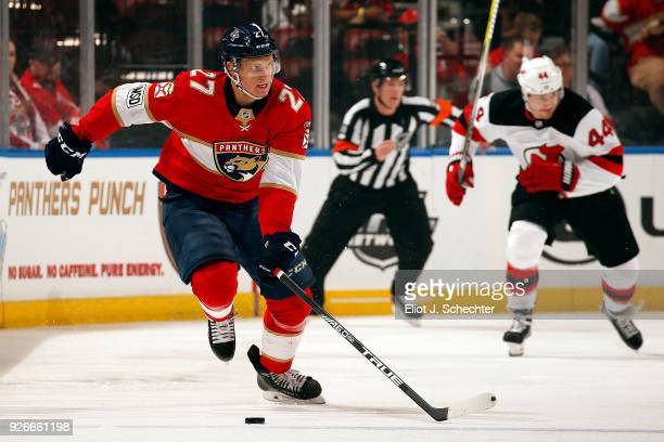 Nick Bjugstad of the Florida Panthers skates with the puck against the New Jersey Devils at the BBT Center on March 1 2018 in Sunrise Florida