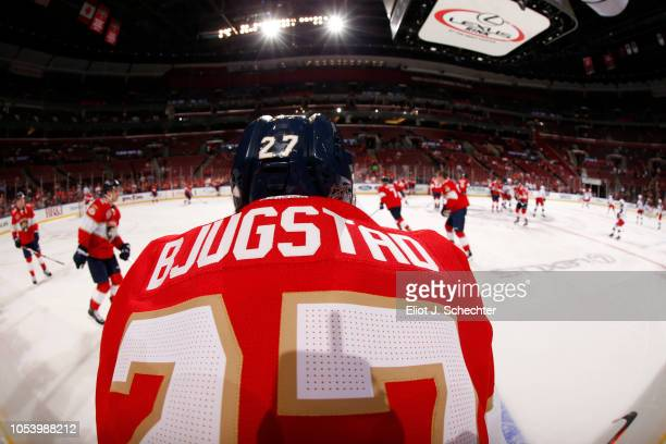 Nick Bjugstad of the Florida Panthers stretches on the ice during warm ups prior to the start of the game against the Columbus Blue Jackets at the...
