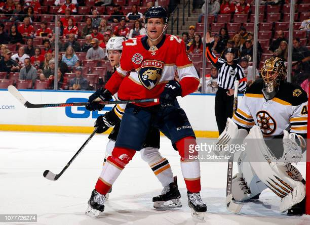 Nick Bjugstad of the Florida Panthers tangles with Torey Krug of the Boston Bruins at the BBT Center on December 4 2018 in Sunrise Florida