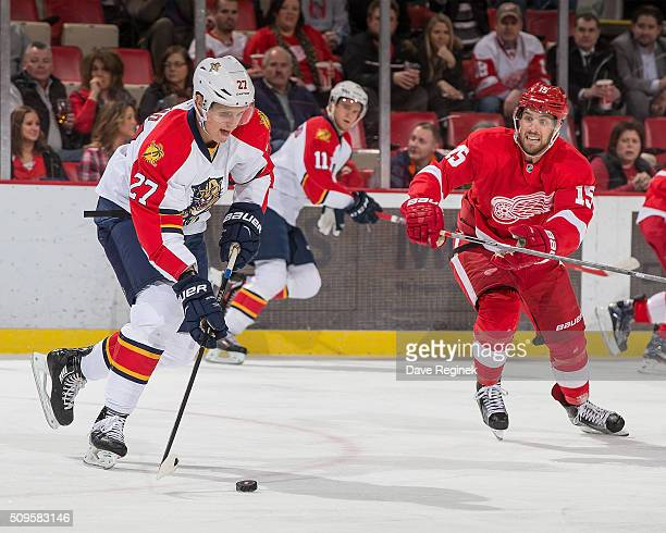 Nick Bjugstad of the Florida Panthers tries to skate past Riley Sheahan of the Detroit Red Wings during an NHL game at Joe Louis Arena on February 8...