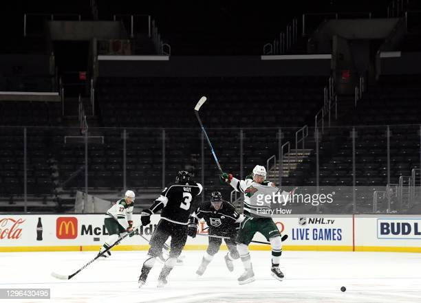 Nick Bjugstad of the Minnesota Wild reacts as he is checked for the puck by Anze Kopitar of the Los Angeles Kings during the first period in the...