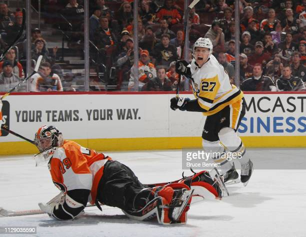 Nick Bjugstad of the Pittsburgh Penguins grimaces after missing a third period shot against Carter Hart of the Philadelphia Flyers at the Wells Fargo...