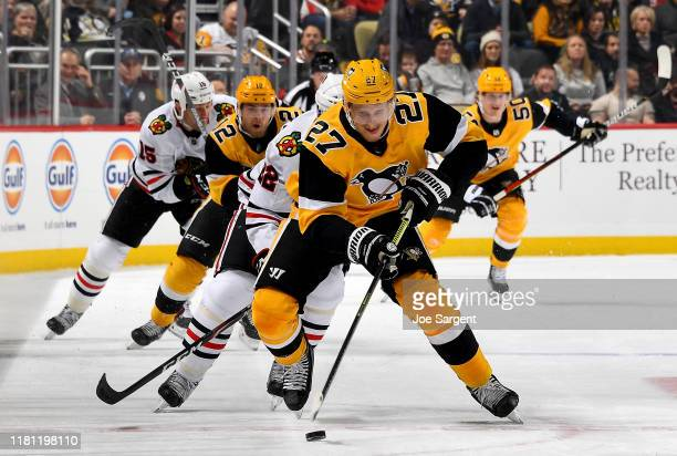 Nick Bjugstad of the Pittsburgh Penguins handles the puck against the Chicago Blackhawks at PPG PAINTS Arena on November 9, 2019 in Pittsburgh,...