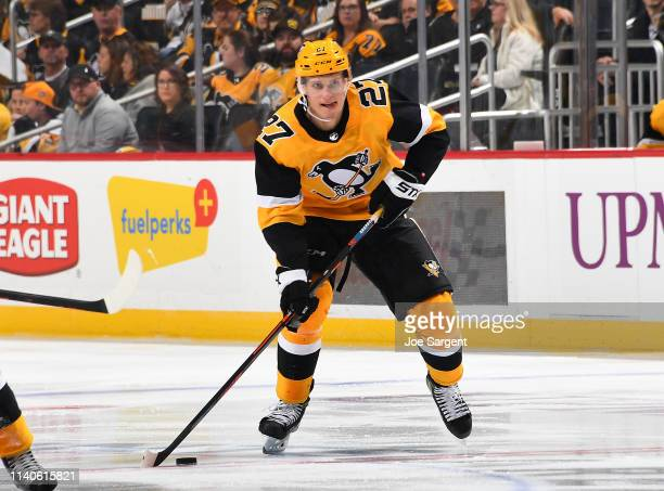 Nick Bjugstad of the Pittsburgh Penguins skates against the Nashville Predators at PPG Paints Arena on March 29, 2019 in Pittsburgh, Pennsylvania.