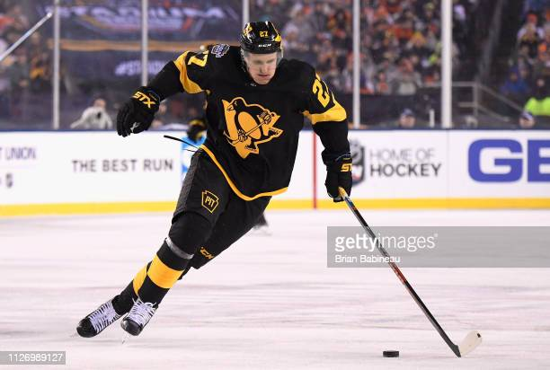 Nick Bjugstad of the Pittsburgh Penguins skates the puck through the neutral zone during the first period of the 2019 Coors Light NHL Stadium Series...