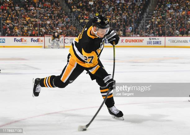 Nick Bjugstad of the Pittsburgh Penguins takes a shot against the Philadelphia Flyers at PPG PAINTS Arena on October 29, 2019 in Pittsburgh,...