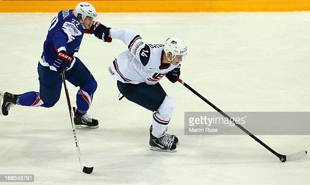 Nick Bjugstad of USA and Brian Henderson of France battle for the puck during the IIHF World Championship group H match between USA and France at...