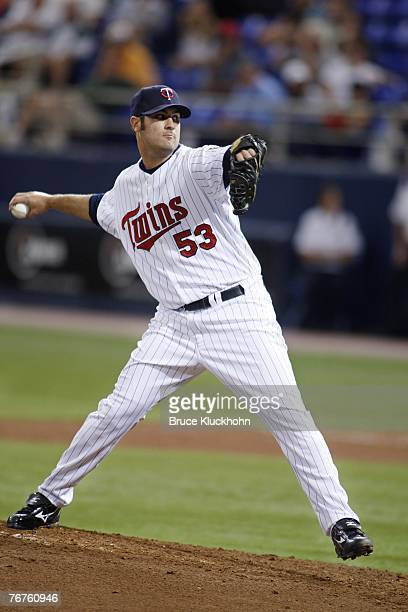 Nick Blackburn of the Minnesota Twins pitches in a game against the Cleveland Indians at the Humphrey Metrodome in Minneapolis, Minnesota on...