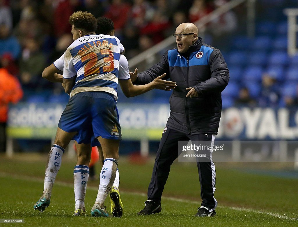 Nick Blackman of Reading celebrates with Reading manager Brian McDermott after scoring an injury time goal to win the game during the Sky Bet Championship match between Reading and Bristol City on January 2, 2016 in Reading, United Kingdom.