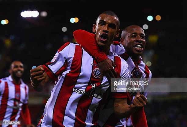Nick Blackman of Sheffield United is congratulated on scoring by Matt Hill during the npower League One match between Sheffield United and Portsmouth...