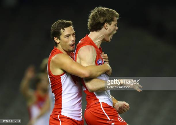 Nick Blakey of the Sydney Swans celebrates with Oliver Florent after scoring a goal during the round 3 AFL match between the North Melbourne...