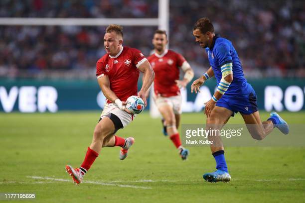 Nick Blevins of Canada offloads the ball during the Rugby World Cup 2019 Group B game between Italy and Canada at Fukuoka Hakatanomori Stadium on...