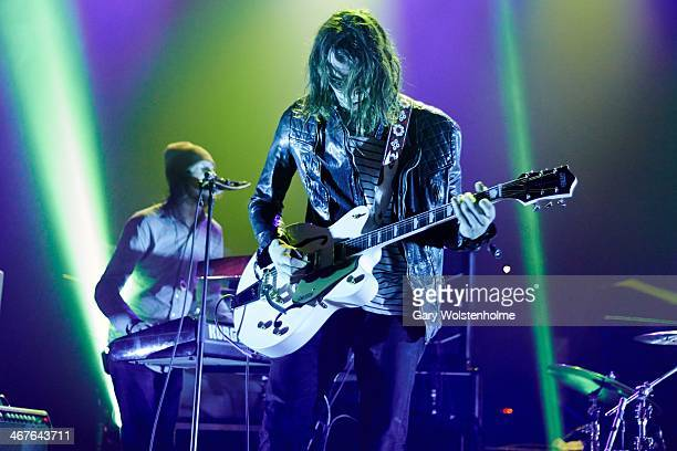 Nick Bockrath of Cage The Elephant performs on stage at Manchester Apollo on February 7 2014 in Manchester United Kingdom