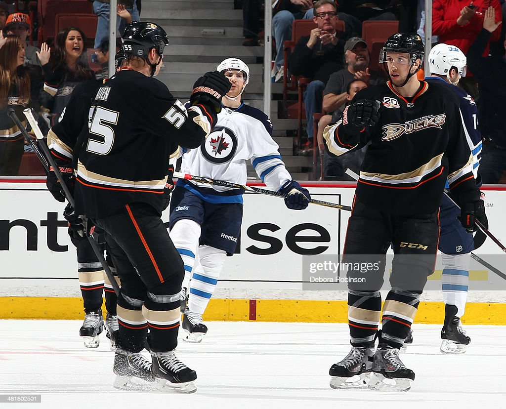 Nick Bonino #13 and Bryan Allen #55 of the Anaheim Ducks celebrate Bonino's second-period goal against the Winnipeg Jets on March 31, 2014 at Honda Center in Anaheim, California.