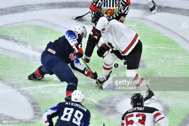 US Nick Bonino and Canada's Kyle Turris fight for the puck during the bronze medal match USA vs Canada of the 2018 IIHF Ice Hockey World Championship...