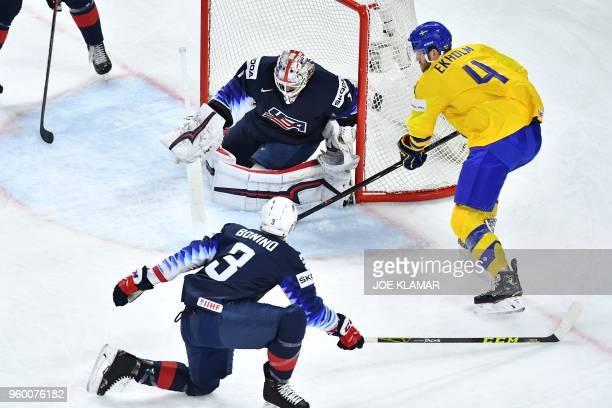 US Nick Bonino and goaltender Keith Kinkaid vie with Sweden's Mattias Ekholm during the semifinal match Sweden vs USA of the 2018 IIHF Ice Hockey...