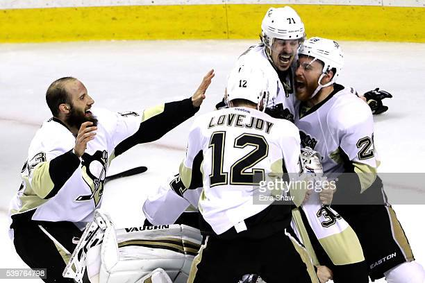 Nick Bonino Ben Lovejoy Evgeni Malkin Ian Cole and Matt Murray of the Pittsburgh Penguins celebrate after their 31 victory to win the Stanley Cup...