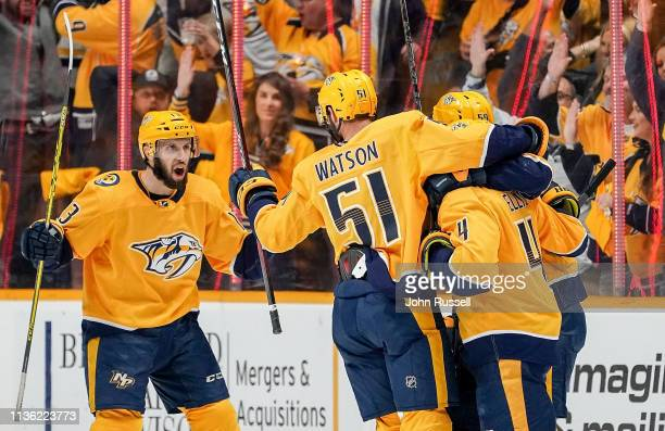 Nick Bonino celebrates a goal with Austin Watson and Roman Josi of the Nashville Predators against the Dallas Stars in Game One of the Western...