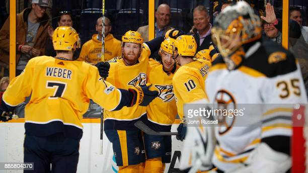 Nick Bonino celebrates his goal with Colton Sissons Matt Irwin and Yannick Weber of the Nashville Predators against Anton Khudobin of the Boston...
