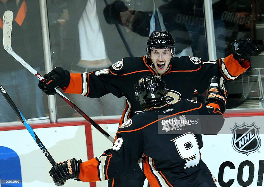 Nick Bonino #13 of the Anaheim Ducks celebrates with Bobby Ryan #9 after scoring his third goal of the game to pick up the hat trick in the third period against the Los Angeles Kings at Honda Center on February 2, 2013 in Anaheim, California. The Ducks won 7-4.