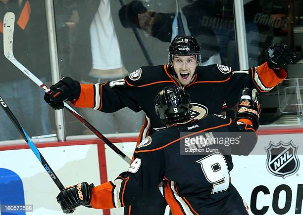 Nick Bonino of the Anaheim Ducks celebrates with Bobby Ryan after scoring his third goal of the game to pick up the hat trick in the third period...