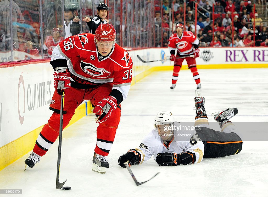 Nick Bonino #63 of the Anaheim Ducks dives to knock the puck away from Jussi Jokinen #36 of the Carolina Hurricanes at the RBC Center on February 23, 2012 in Raleigh, North Carolina.