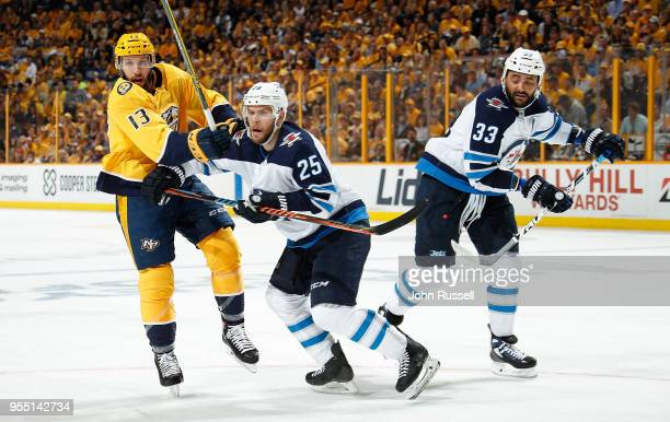Nick Bonino of the Nashville Predators battles against Paul Stastny and Dustin Byfuglien of the Winnipeg Jets in Game Five of the Western Conference...