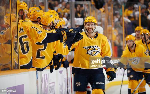 Nick Bonino of the Nashville Predators celebrates his goal with the bench against the Washington Capitals during an NHL game at Bridgestone Arena on...