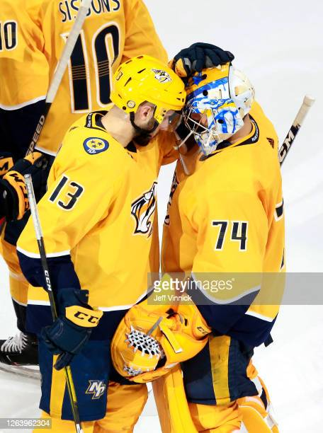 Nick Bonino of the Nashville Predators congratulates Juuse Saros after the 4-2 win over the Arizona Coyotes in Game Two of the Western Conference...