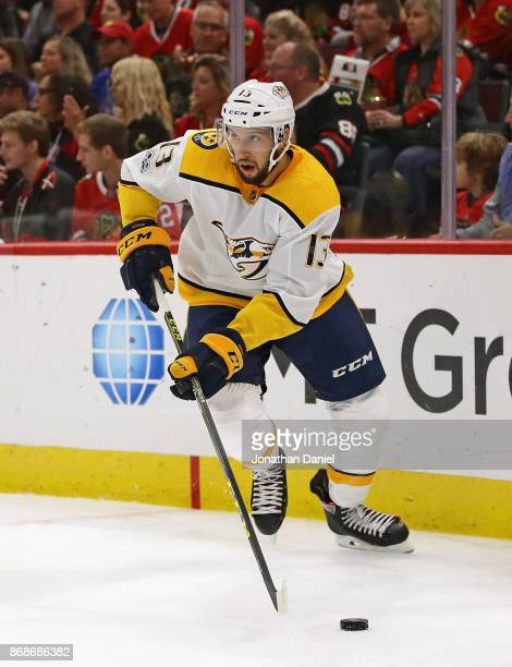 Nick Bonino of the Nashville Predators controls the puck against the Chicago Blackhawks at the United Center on October 14 2017 in Chicago Illinois...