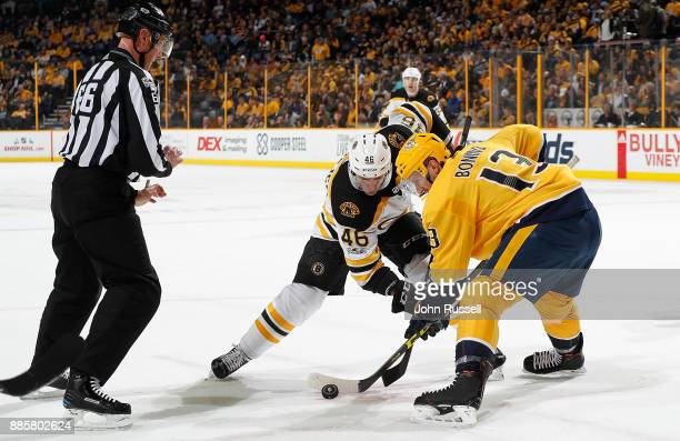Nick Bonino of the Nashville Predators faces off against David Krejci of the Boston Bruins during an NHL game at Bridgestone Arena on December 4 2017...