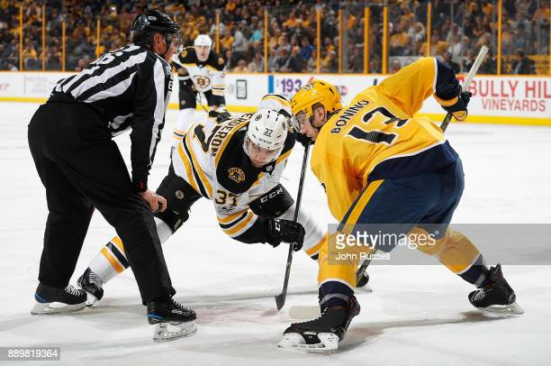 Nick Bonino of the Nashville Predators faces off against Patrice Bergeron of the Boston Bruins during an NHL game at Bridgestone Arena on December 4...