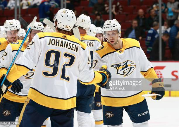Nick Bonino of the Nashville Predators is congratulated by teammate Ryan Johansen after their win over the Vancouver Canucks during their NHL game at...