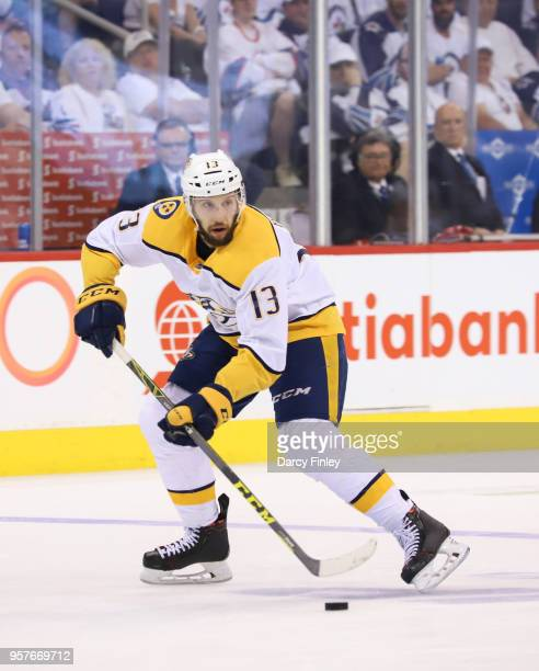 Nick Bonino of the Nashville Predators plays the puck down the ice during third period action against the Winnipeg Jets in Game Six of the Western...