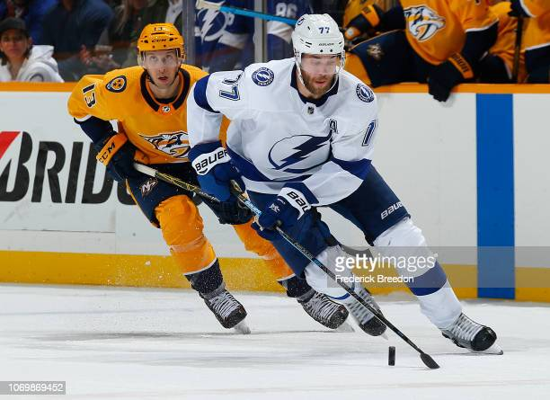 Nick Bonino of the Nashville Predators pursues Victor Hedman of the Tampa Bay Lightning during the third period at Bridgestone Arena on November 19...