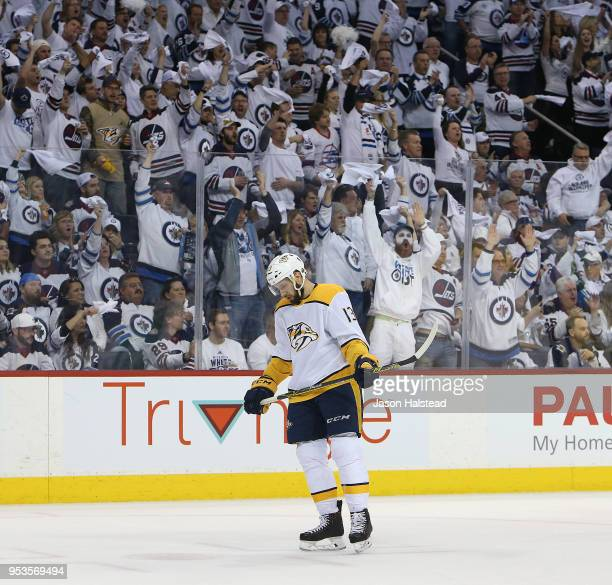 Nick Bonino of the Nashville Predators reacts after a Winnipeg Jets goal in Game Three of the Western Conference Second Round during the 2018 NHL...