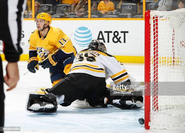 Nick Bonino of the Nashville Predators scores against Anton Khudobin of the Boston Bruins during an NHL game at Bridgestone Arena on December 4 2017...