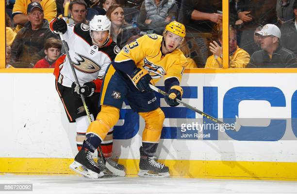 Nick Bonino of the Nashville Predators skates against Adam Henrique of the Anaheim Ducks during an NHL game at Bridgestone Arena on December 2 2017...