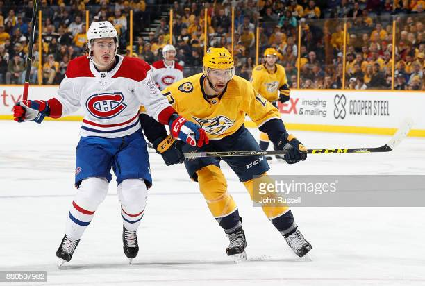 Nick Bonino of the Nashville Predators skates against Charles Hudon of the Montreal Canadiens during an NHL game at Bridgestone Arena on November 22...